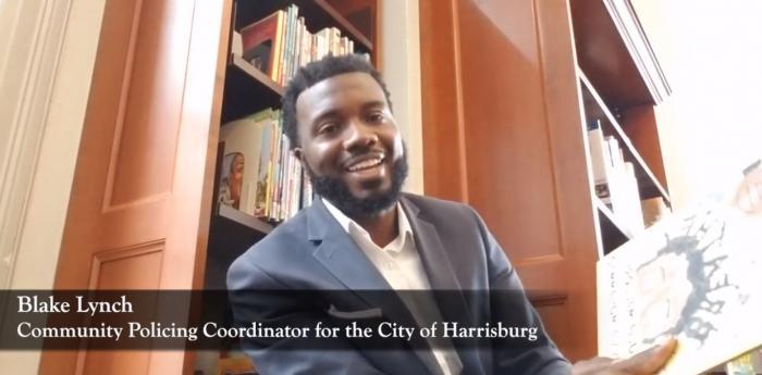 City of Harrisburg Community Policing Coordinator Blake Lynch reads Breathe by Julia Mallory